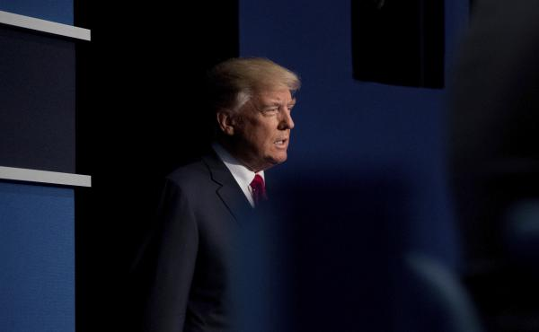 Then-candidate Donald Trump walks onstage at a presidential debate in St. Louis two days after a video was released, in which he is heard talking to Access Hollywood host Billy Bush about sexually assaulting women.