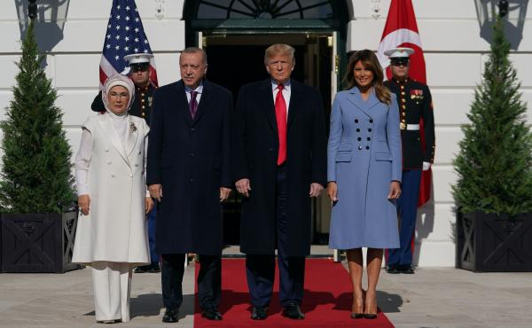 President Trump and first lady Melania Trump meet with Turkey's President Recep Tayyip Erdogan and his wife, Emine Erdogan, outside the White House on Wednesday.