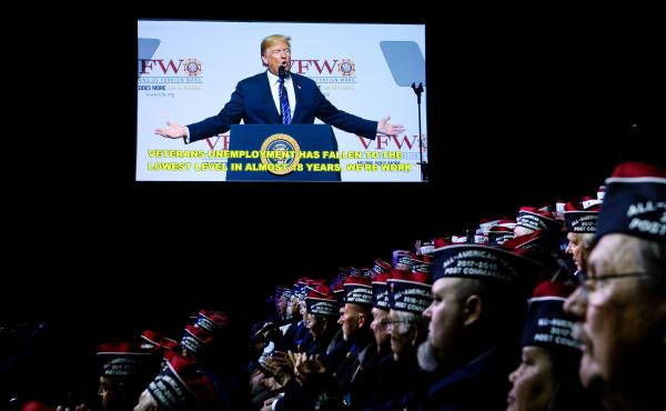 President Donald Trump seen on a video screen as he speaks at the 119th Veterans of Foreign Wars National Convention, Tuesday in Kansas City, Mo.