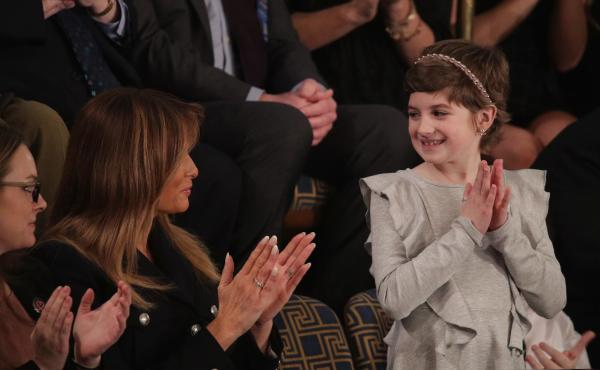 First lady Melania Trump with 10-year-old Grace Eline, a guest of President Trump at the State of the Union address Tuesday. Grace was diagnosed with brain cancer last year. Trump cited her experience in calling for more research into childhood cancer tre