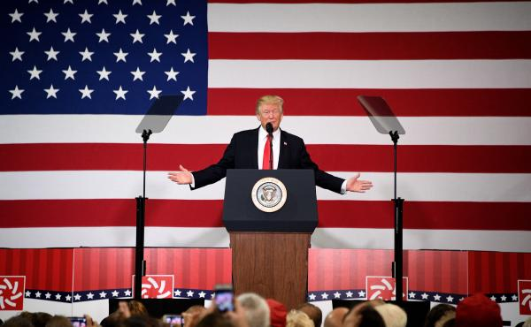 President Trump participates in a tax overhaul kickoff event at the Loren Cook Company in Springfield, Mo., on Wednesday.