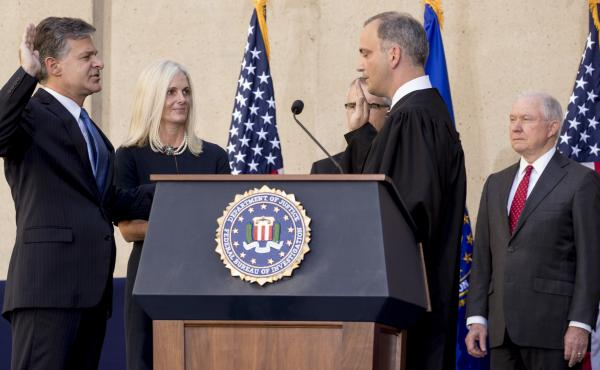 FBI Director Chris Wray, accompanied by his wife, Helen Garrison Howell, FBI Deputy Director Andrew McCabe and Attorney General Jeff Sessions, is administered the ceremonial oath of office by U.S. District Judge Joseph Bianco during Thursday's installatio