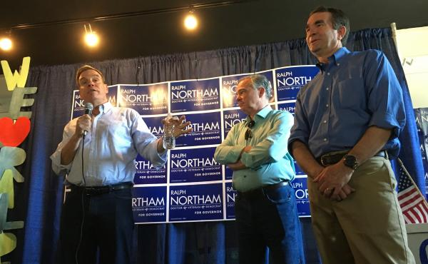 Virginia Sens. Mark Warner and Tim Kaine campaign for Lt. Gov. Ralph Northam for governor during a canvass kickoff on Saturday in Arlington, Va.