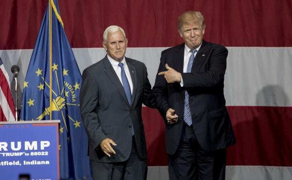 Donald Trump greets Indiana Gov. Mike Pence at the Grand Park Events Center on Tuesday in Westfield, Ind.