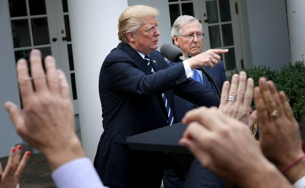 President Trump and Senate Majority Leader Mitch McConnell, R-Ky., talk to reporters in the Rose Garden following a lunch meeting at the White House on Monday. The two tried to downplay reports of divisions between them.