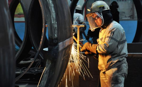 A worker cuts steel in Qingdao in China's eastern Shandong province. President Trump said Thursday that he plans to impose tariffs on U.S. imports of steel and aluminum.