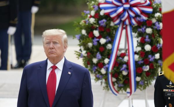President Donald Trump participates in a wreath laying ceremony at Arlington National Cemetery on Monday. Trump went on to deliver Memorial Day remarks at Fort McHenry in Baltimore.