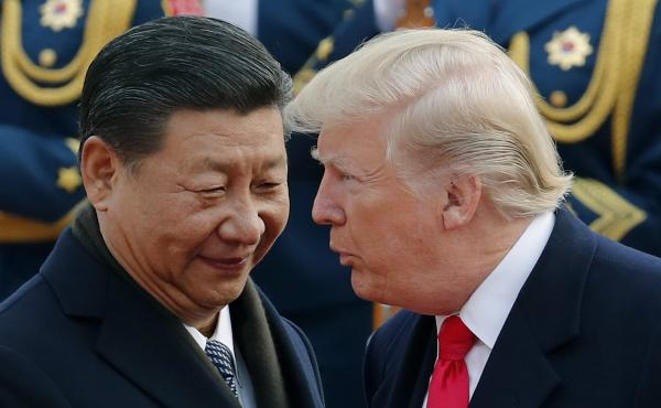 President Donald Trump chats with Chinese President Xi Jinping during a welcome ceremony in Beijing on Nov. 9. The Trump administration is expected to release the results of an investigation into Chinese trade practices, a move that could lead to sanction