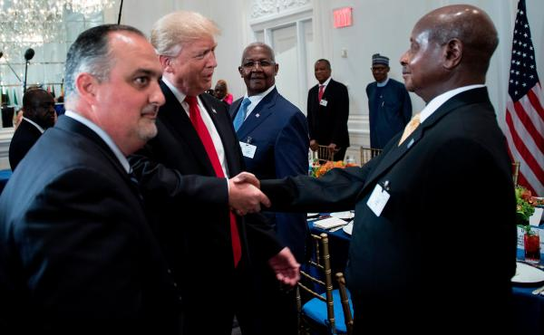 President Donald Trump greets Uganda's President Yoweri Museveni (right) before a luncheon with U.S. and African leaders during the United Nations General Assembly.