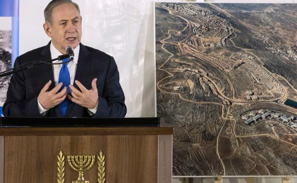 Israeli Prime Minister Benjamin Netanyahu delivers a speech during a memorial ceremony for the founder of Ariel, one of the largest Israeli settlements in the occupied West Bank on Thursday.