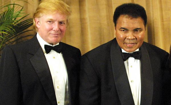 In this file photo, Muhammad Ali is honored on March 14, 2001, receiving the UCP's Humanitarian Award from Donald Trump at the United Cerebral Palsy dinner at the New York Marriott Marquis Hotel in New York City.