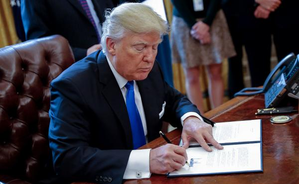 President Trump signed an executive order related to the oil pipeline industry in the Oval Office on January 24.