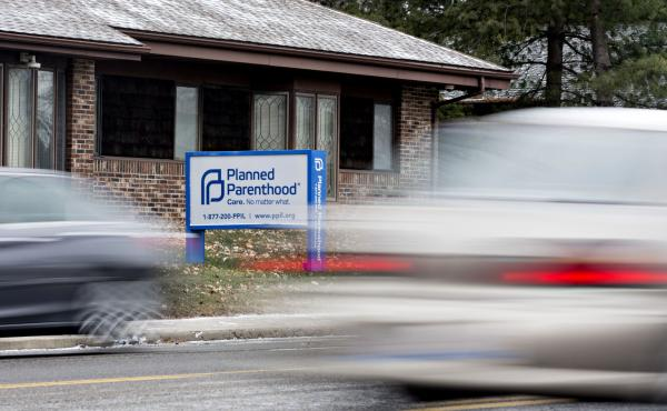 Vehicles drive past a Planned Parenthood office in Peoria, Ill., in December 2016.
