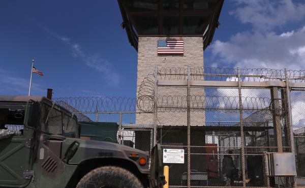 "A humvee passes the guard tower guard tower at the entrance of the U.S. prison at Guantanamo Bay, also known as ""Gitmo"" in October 2016. October 23, 2016 at the U.S."