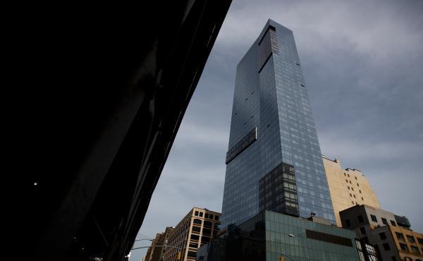 Trump SoHo Hotel Condominium looms over its neighborhood of Hudson Square in lower Manhattan.