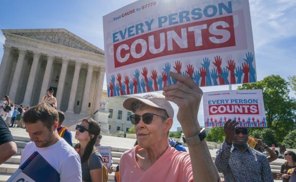 Demonstrators rally outside the U.S. Supreme Court in April 2019 to protest against the Trump administration's efforts to add the now-blocked citizenship question to the 2020 census.