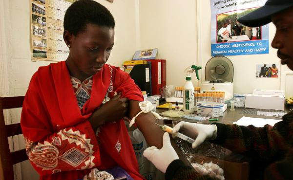 A young woman is tested for HIV at a health clinic in Uganda. During the presidency of George W. Bush, the U.S. substantially ramped up spending on HIV/AIDS programs abroad — a commitment that retains strong bipartisan support to this day.