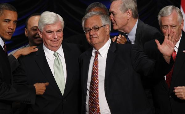 Sen. Chris Dodd and Rep. Barney Frank celebrate as their Dodd-Frank banking regulation bill is signed into law in 2010. President-elect Donald Trump has said he is interested in doing away with it.