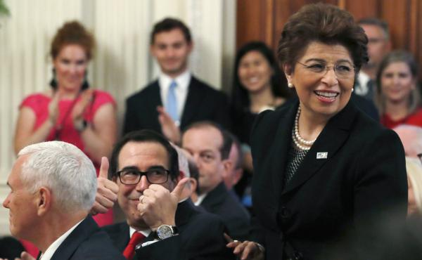 Treasury Secretary Steve Mnuchin gives two thumbs up for U.S. Treasurer Jovita Carranza in 2018. On Thursday, President Trump announced that he will nominate Carranza to lead the Small Business Administration.