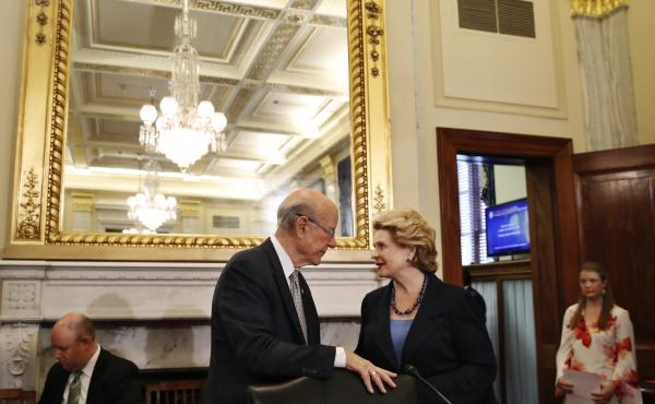 Sen. Pat Roberts, R-Kan., chairman of the Senate Agriculture Committee, left, speaks with Ranking Member Sen. Debbie Stabenow, D-Mich., during a meeting of the committee in June, to consider a bipartisan farm bill.