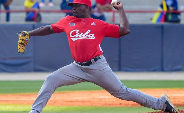 Alexis Rivero of Cuba's Los Leñeros de Las Tunas pitches during a Caribbean Series match against Venezuela's Cardenales de Lara in Panama City on Feb. 6. Major League Baseball had made a deal with Cuba's baseball federation to allow Cuban athletes to pla