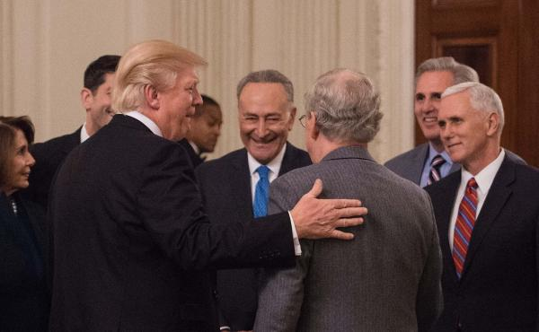 President Trump's cooperation with congressional Democratic leaders Nancy Pelosi (left) and Chuck Schumer (center) appears to have won public approval.