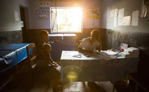 A patient talks with a nurse at a traveling contraception clinic in Madagascar run by the British nonprofit group Marie Stopes International. The organization is one of many that has decided to give up U.S. funding because it deems Trump's ban on providin