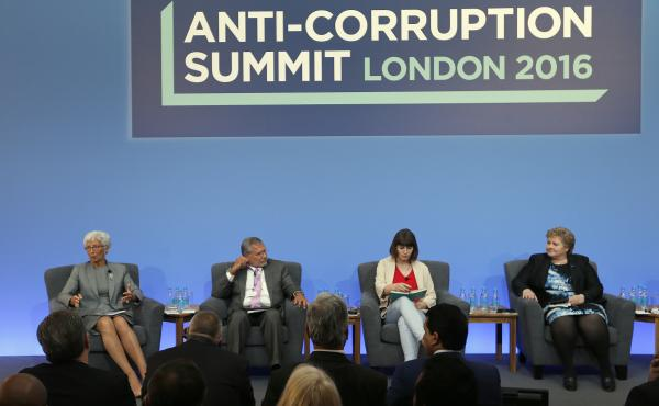 International Monetary Fund Managing Director Christine Lagarde (from left), Jose Ugaz of Transparency International, Daria Kaleniuk of the Anti-Corruption Action Center, and Norway's Prime Minister Erna Solberg participate in a panel discussion at the An