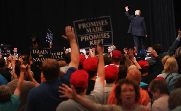 President Donald Trump leaves the stage following a rally on June 21, 2017 in Cedar Rapids, Iowa.