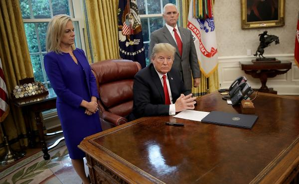 President Trump, with DHS Secretary Kirstjen Nielsen, left, and Vice President Pence, right, prepares to sign an executive order ending the practice of separating migrant families. But the move leaves many questions unanswered.