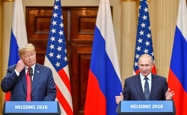 Presidents Trump and Vladimir Putin hold a joint news conference after a meeting at the Presidential Palace in Helsinki on Monday.