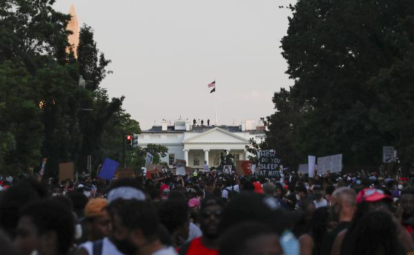 Demonstrators protest Saturday near the White House.