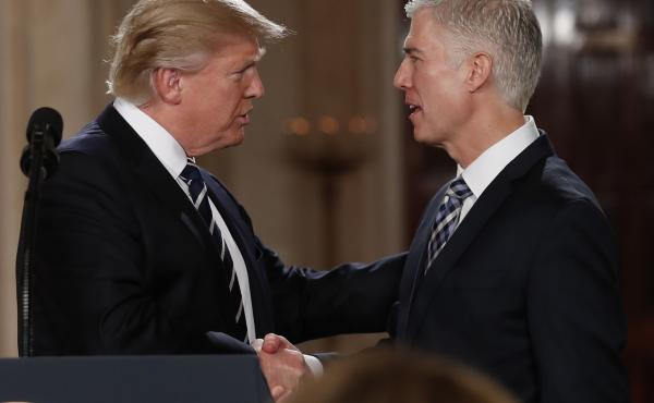 President Trump shakes hands with Neil Gorsuch, his first pick for a spot on the U.S. Supreme Court, on Jan. 31, 2017. The president will likely have the opportunity to name a replacement for Justice Ruth Bader Ginsburg, who died Friday.
