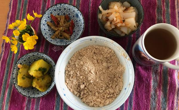 A bowl of tsampa flour pictured with other dishes in a typical Tibetan lunch. Counterclockwise from left: potatoes in turmeric and cumin; liangfen; mung bean jelly and spring onions with cilantro, triple-fried in red chili pepper; and black tea. To make <