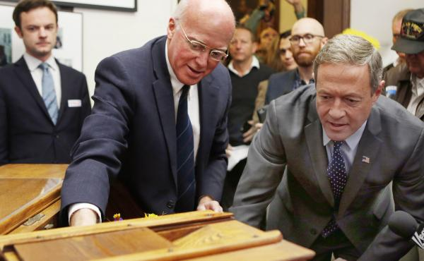 New Hampshire secretary of state Bill Gardner, left, shows former Maryland Gov. Martin O'Malley, the historic ballot box before O'Malley filed papers to run in the 2016 presidential primary. Gardner is the nation's longest-serving secretary of state and h