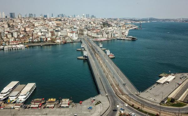 An aerial picture shows the Galata Bridge and the Bosporus in Istanbul on Saturday, as the Turkish government imposed a two-day curfew to prevent the spread of COVID-19.