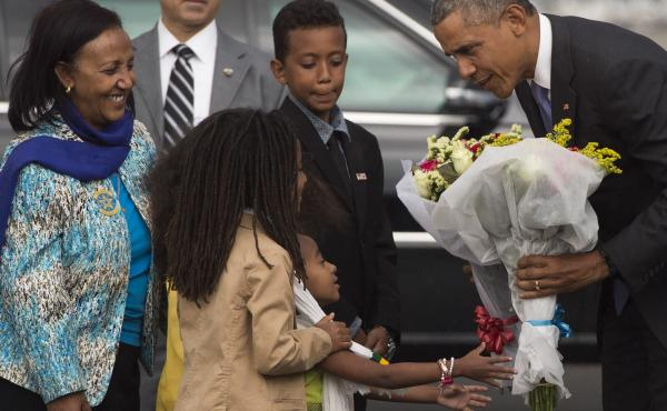 President Obama receives flowers upon his arrival Sunday aboard Air Force One at Bole International Airport in Addis Ababa, Ethiopia.