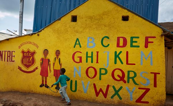 In his new book for young teenagers, Charles Kenny points out signs of global progress, including the growing number of kids in school. Above: The Oloo Education Center aims to provide an education to kids in Kibera, a poor community in Nairobi, Kenya. Wh