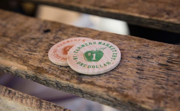 Tokens representing $1, which can be used specifically for fresh fruits and vegetables, are displayed at a Electronic Benefits Transfer, or food stamp, station in the GrowNYC Greenmarket in Union Square on September 18, 2013 in New York City.