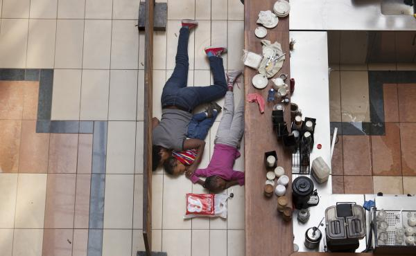 Tyler Hicks took this photo of a woman sheltering her children on the floor of a cafe at the Westgate Mall during an attack by militants in Nairobi on Sept. 21, 2013. The woman later contacted Hicks and told him she kept her kids quiet and still by singin