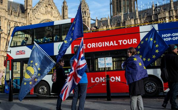 Pro-European Union protesters demonstrate against Brexit outside the House of Parliament on Tuesday in London, as Prime Minister Theresa May was reaching an agreement with the EU.