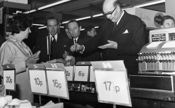 On the day of the official change to decimalized currency on Feb. 15, 1971, Lord Fiske, chairman of the Decimal Currency Board, makes a purchase at a Woolworths store in London.