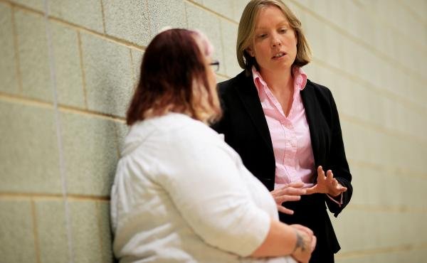 U.K. Minister for Sport and Civil Society Tracey Crouch talks to a woman during a visit to Norwich, England, in 2015. Crouch has been selected to be the U.K. minister for loneliness.