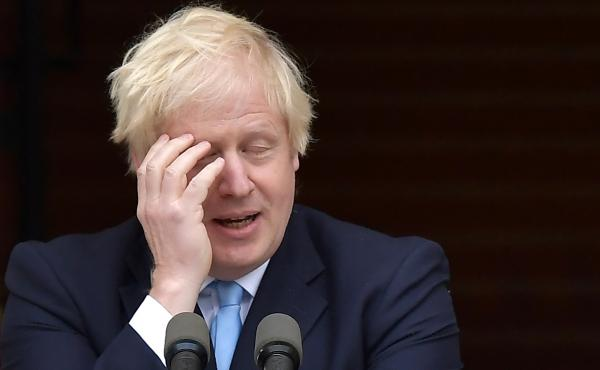 British Prime Minister Boris Johnson, seen at a joint news conference Monday with Irish Taoiseach Leo Varadkar in Dublin. Johnson has suffered a rough couple of weeks, as lawmakers scuttled first his attempt to maintain a hard Brexit deadline — then, hi