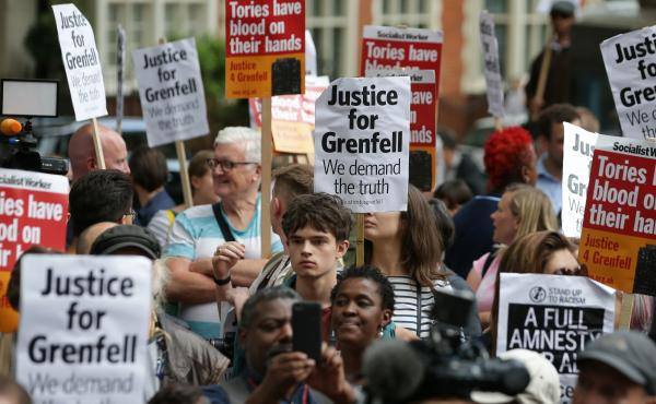 Londoners protest outside a Kensington Council meeting to discuss Grenfell Tower on July 19. British police say there are grounds to suspect the council and other local authorities of committing corporate manslaughter in the fire that killed at least 80 p