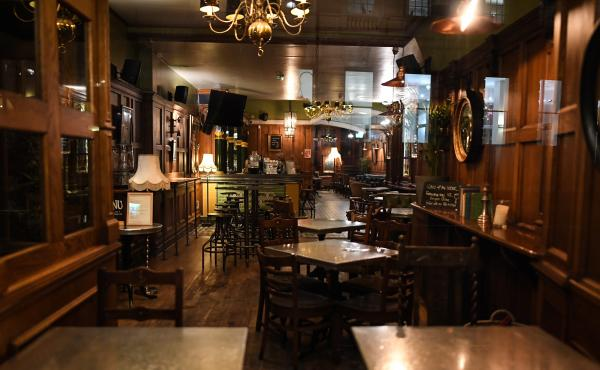 An empty pub in London. On Friday, British Prime Minister Boris Johnson announced that the country's bars, pubs, restaurants and cafes must close  to curb the spread of COVID-19, which has killed more than 100 people in the U.K.
