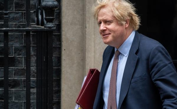 British Prime Minister Boris Johnson, shown here leaving Downing Street in London on Wednesday, published a column in The Times of London urging China to rethink its proposed national security law.