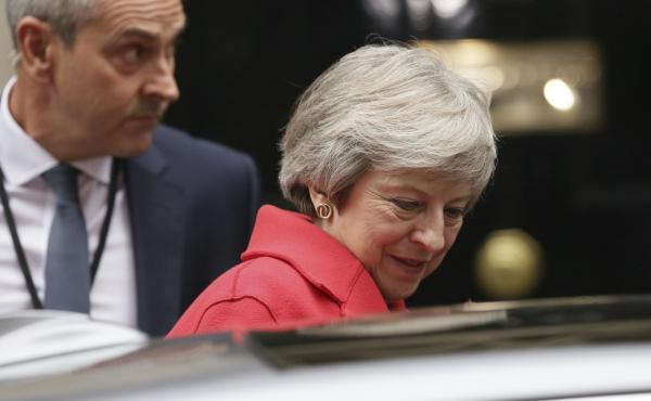 British Prime Minister Theresa May leaves No. 10 Downing St. for the Houses of Parliament on Thursday. Her speech there defending the tentative Brexit deal did little to calm critics — either among her political rivals or within her own party.