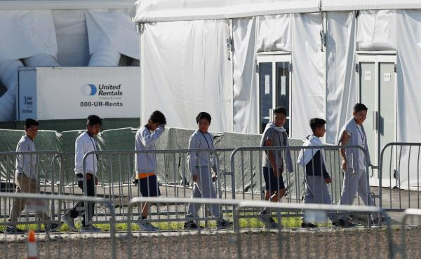 """The leader of a U.N. study on children's rights says of the U.S. policy of separating migrant children from their families, """"I would call it inhuman treatment for both the parents and the children."""" Here, children are seen near a tent at the Homestead Tem"""