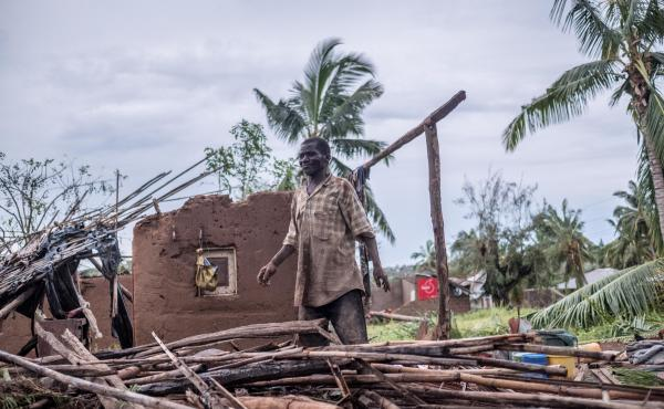 A man stands in his wrecked home in Macomia, Mozambique, after Cyclone Kenneth in April. It was the second intense cyclone to strike the country in six weeks.